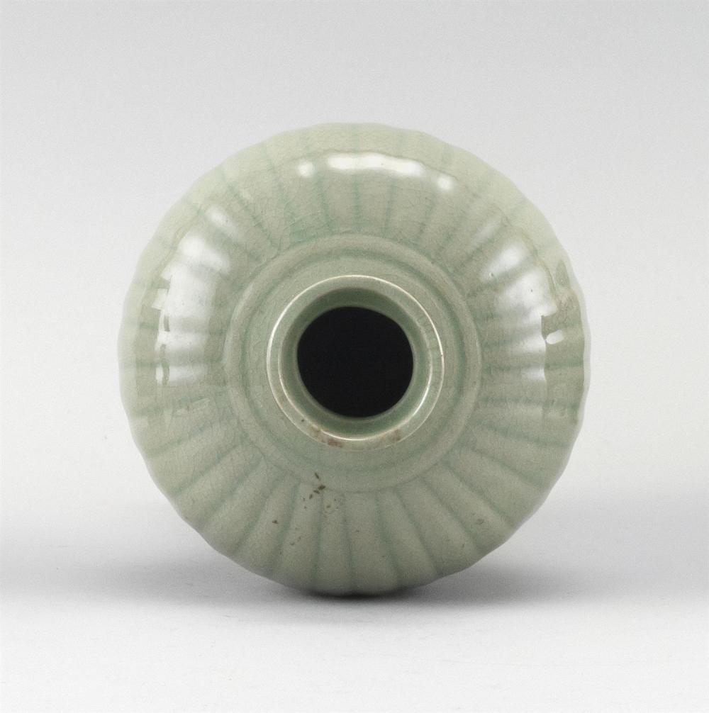 "Lot 1181: KOREAN CELADON PORCELAIN VASE In meiping form, with ribbed body. Height 8.5""."