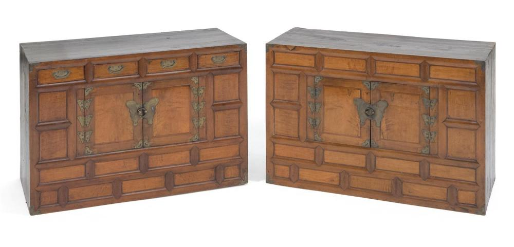Lot 1182: KOREAN CAMPHORWOOD TWO-PART CHEST-ON-CHEST Paneled cases with metal butterfly mounts and metal corner mounts. Base with four half dr...