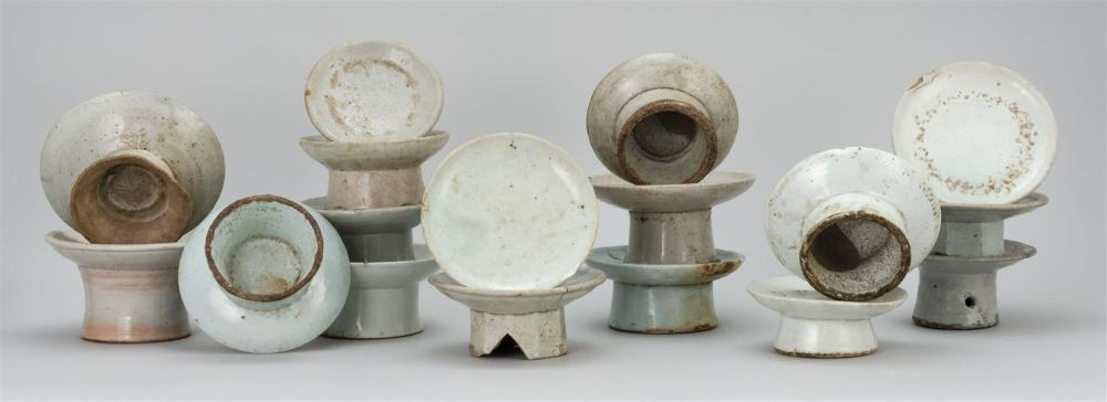 Lot 1187: COLLECTION OF SEVENTEEN KOREAN WHITE STONEWARE CUP STANDS Sizes vary.