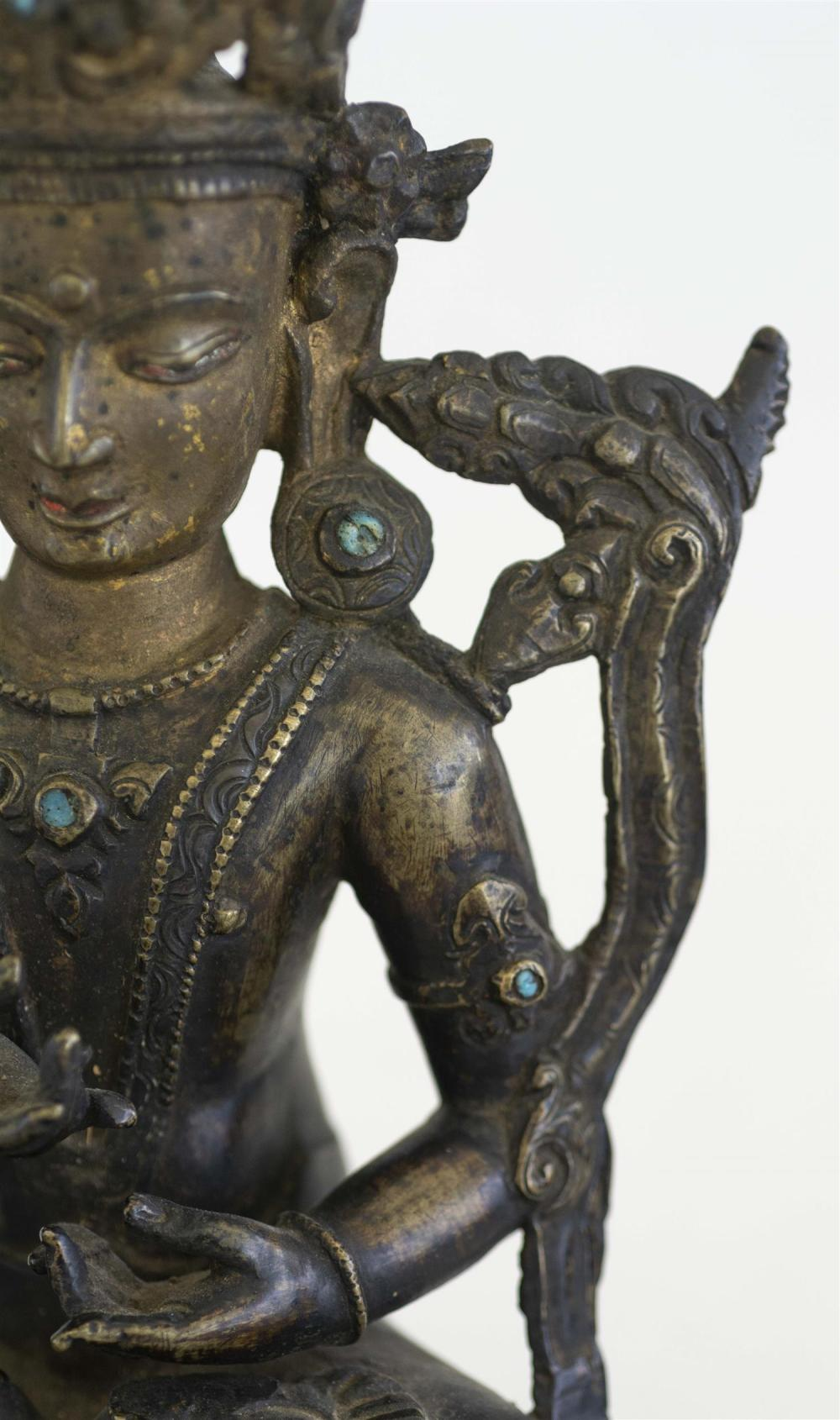 NEPALESE BRONZE FIGURE OF BUDDHA In seated position on a lotus throne. Inset turquoise details. Height 10.25
