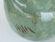 """Lot 1188: KOREAN CELADON VASE In gourd form, with underglaze red, white and dark green abstract decoration on a crackled ground. Height 14.5""""."""