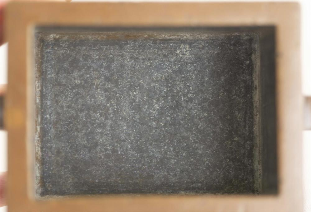 CHINESE BRONZE CENSER Rectangular, with applied handles and conforming base. Two-character mark beneath censer. Length 5.25