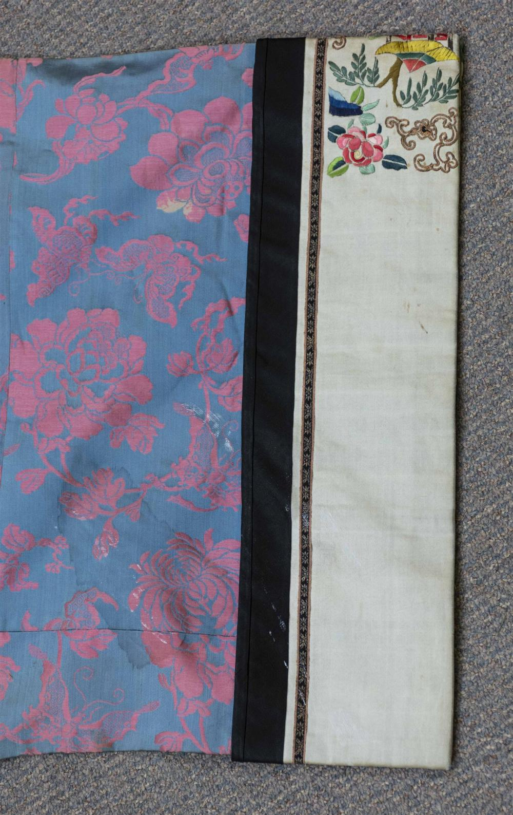 Lot 1143: CHINESE SILK BROCADE JACKET With pink peony design on a gray-blue ground. Sleeve bands with forbidden stitch and gold threadwork in...