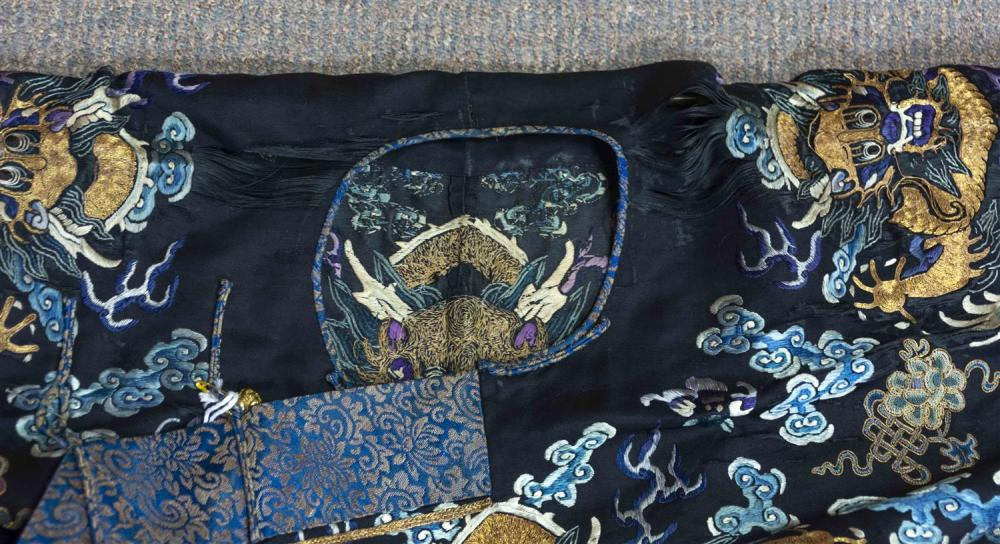 Lot 1138A: CHINESE GOLD AND SILK NEEDLEWORK DRAGON ROBE With gold five-clawed dragons and dragon rondels.