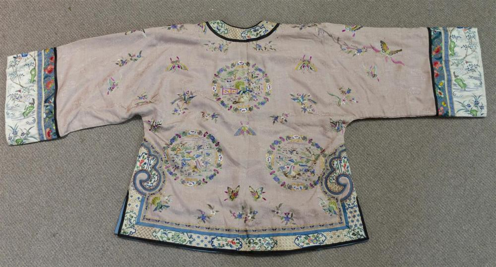 Lot 1135: CHINESE SILK NEEDLEWORK AND BROCADE JACKET With butterfly and peacock rondel design on a pink ground.