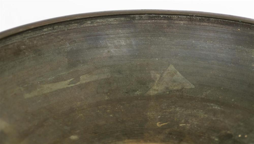 CHINESE XUANDE BRONZE FOOTED BOWL In lotus form, with rich brown patina. Six-character mark. Diameter 15