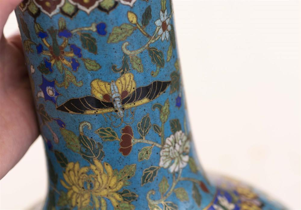 CHINESE CLOISONNÉ ENAMEL VASE In mallet form, with flower and butterfly design on a blue ground. Height 12.75