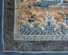 """Lot 1153: THREE CHINESE TEXTILES Two phoenix and cloud mandarin badges, diameter 12"""" and 11"""" x 10"""", and a silk needlework depicting a dragon a..."""