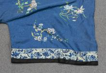 Lot 1139: TWO CHINESE SILK NEEDLEWORK ROBES Both with floral designs on a sky blue ground.