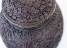 Lot 1163: PAIR OF CHINESE CINNABAR COVERED JARS In elongated ovoid form, with carved figural landscape on bodies. Domed covers with onion fini...