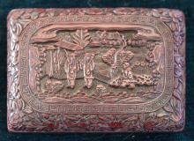 "Lot 1160: CHINESE CINNABAR BOX Rectangular, with relief figural landscape design. Six-character Qianlong mark on base. Length 5.75""."