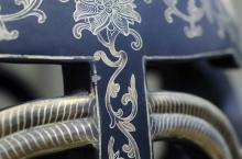 Lot 1158: PAIR OF CHINESE BLACK LACQUERED WOOD GARDEN SEATS Sides with an openwork gilt rope-like framework. Tops and bases with floral and sw...