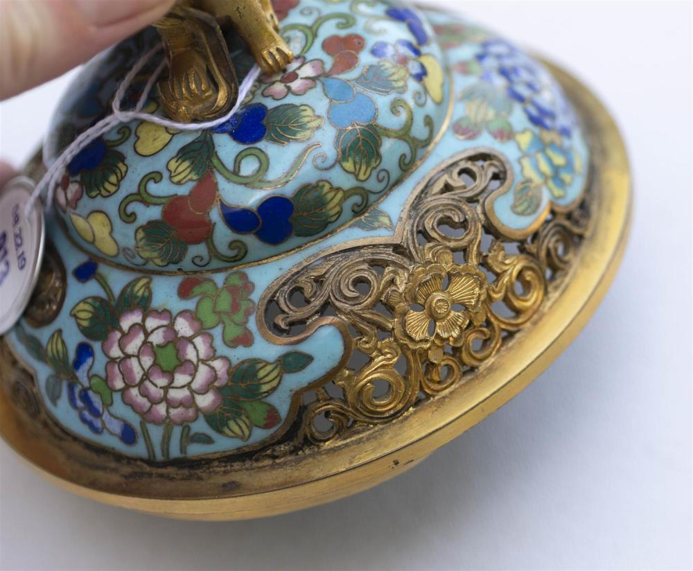 CHINESE CLOISONNÉ ENAMEL KORO In tripod ovoid form, with domed cover, lion finial, and elephant's-head feet. Body decorated with but..