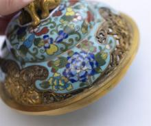 Lot 913: CHINESE CLOISONNÉ ENAMEL KORO In tripod ovoid form, with domed cover, lion finial, and elephant's-head feet. Body decorated with but..