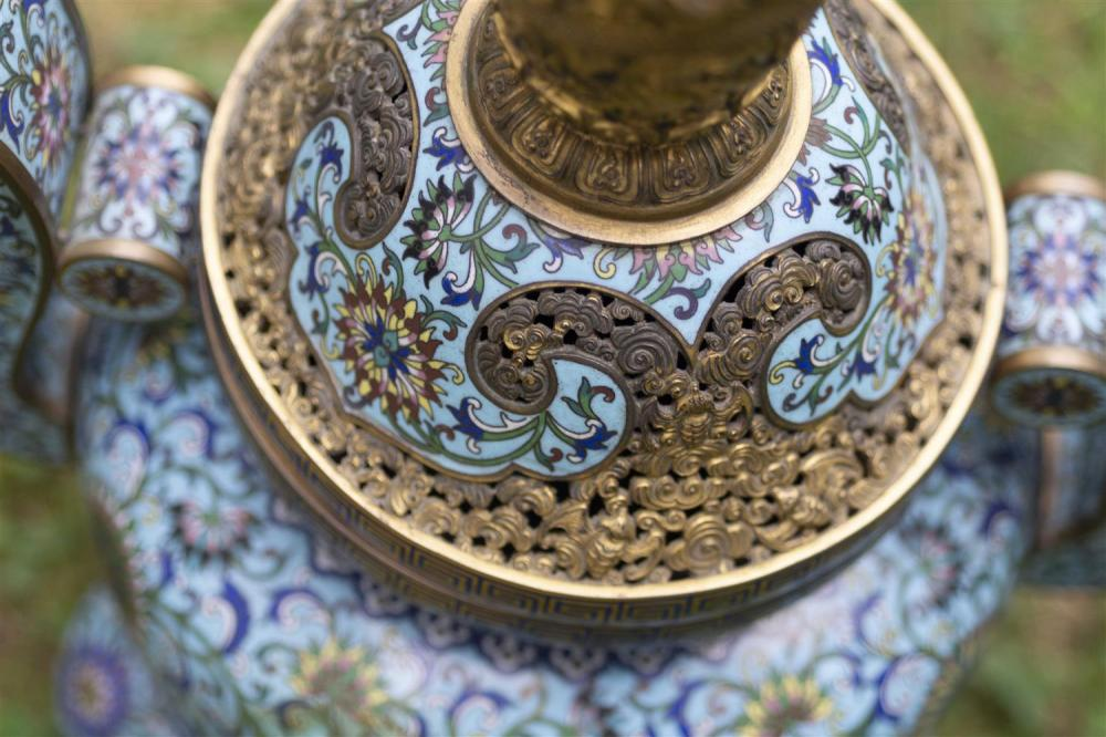 CHINESE CLOISONNÉ ENAMEL KORO In tripod ovoid form, with upswept handles, domed cover and gilt-bronze dragon finial. Body decorated...