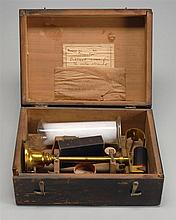 CASED STEELYARD DENSITY BALANCE (Probably German, Late 19th Century). Includes brass measure-on-stand, glass beaker, and thermometer...