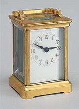 FRENCH CARRIAGE CLOCK. Brass case with beveled glass. Height 4¼