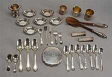 THIRTY ASSORTED STERLING SILVER ITEMS together with a sterling silver-mounted two-piece salad set. Includes spoons, shot glasses, pa...