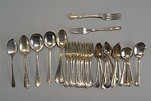 THIRTY-ONE PIECES OF STERLING SILVER FLATWARE by various makers. Includes ten dessert forks, two dinner forks, five cream soup spoon...
