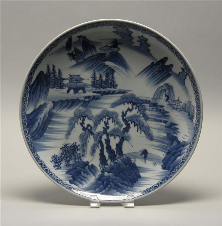 "BLUE AND WHITE PORCELAIN CHARGER Depicting a traveler and pavilions in a landscape. Diameter 15"" (38.2 cm)."