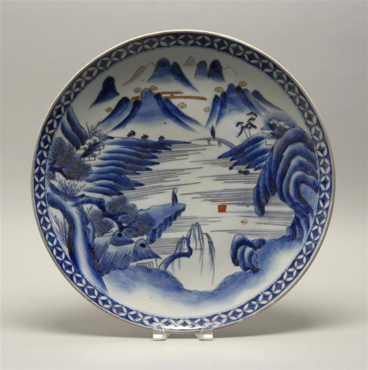 "BLUE AND WHITE IMARI PORCELAIN CHARGER With mountain and river landscape design. Diameter 18"" (46 cm)."