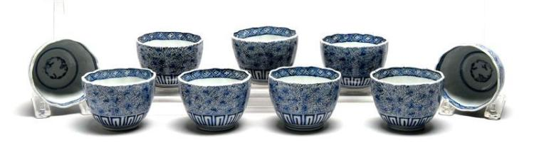 """NINE BLUE AND WHITE ARITA PORCELAIN BOWLS With Greek key and flower decoration. Height 3.25"""" (8.25 cm). Diameter 2.5"""" (6.3 cm)."""