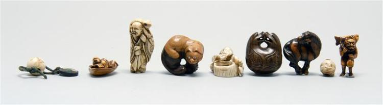 SEVEN NETSUKE AND TWO OJIME A wood bell, Metropolitan Museum of Art copy of a horse, wood cat, two stained bone figures, 18th Centur...