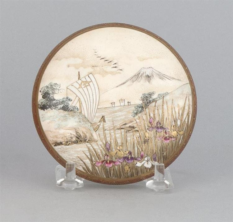 SATSUMA POTTERY BOX Decorated on the cover with boats and iris beneath Mount Fuji; on interior with grasses, hat, and banner design....