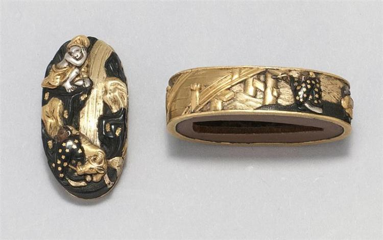 INLAID SOTEN SCHOOL FUCHI KASHIRA With gold and silver depiction of sages beneath a waterfall and a sage and attendant beside a brid...