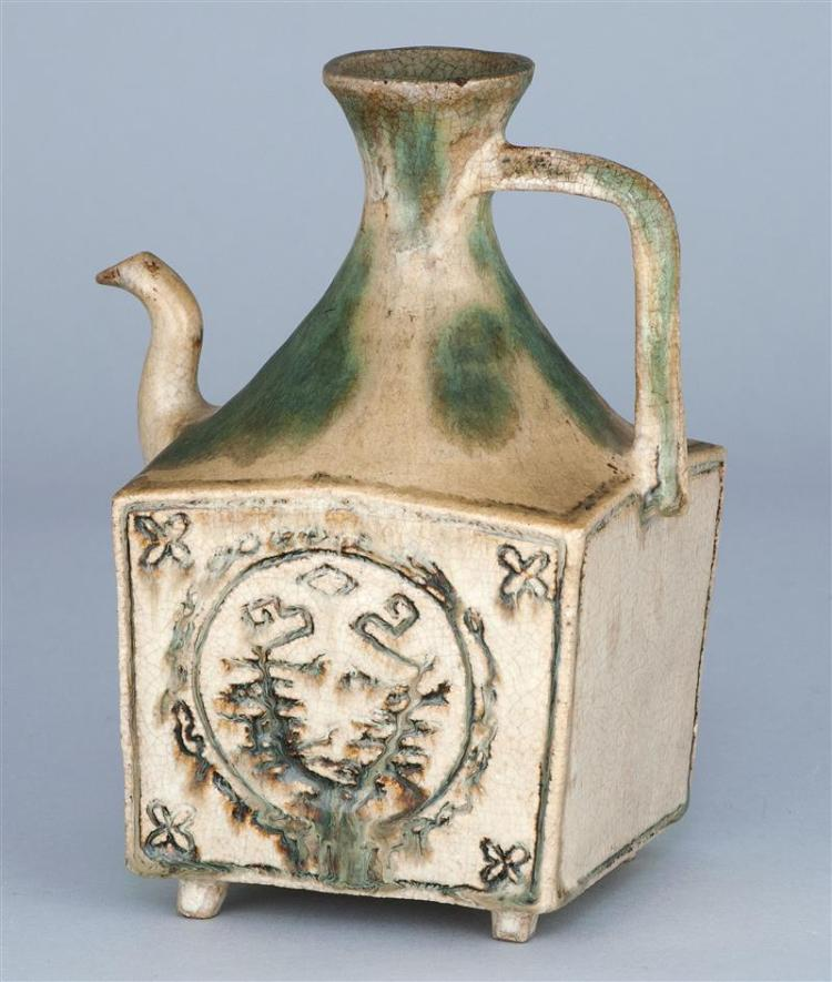 SHINO POTTERY WINE EWER With a funnel neck and handle on a squared body. Incised decoration in cartouches on two sides. On four smal...