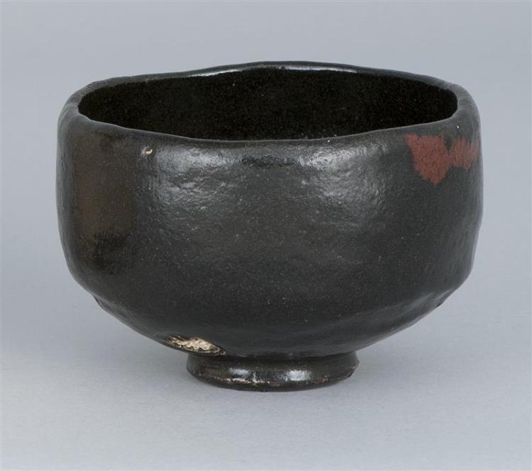 "BLACK RAKU POTTERY CHAWAN With circular potter's mark at foot. Diameter 4.5"" (11.5 cm)."