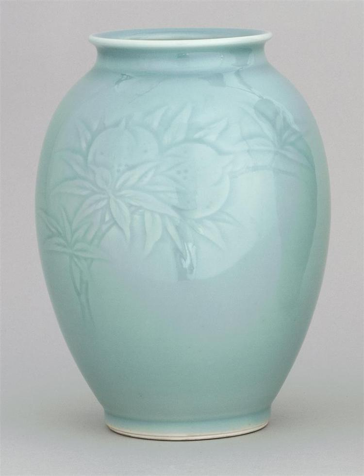 """STUDIO PORCELAIN VASE In seed form with raised peach branch decoration in an allover celadon glaze. Signed on base, possibly """"Sengak..."""
