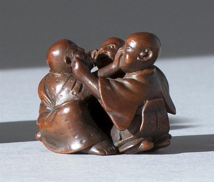 "WOOD NETSUKE By Hogen. Depicting three blind men, signifying ""hear no evil, see no evil, speak no evil"". Signed. Height 1"" (2.5 cm)."