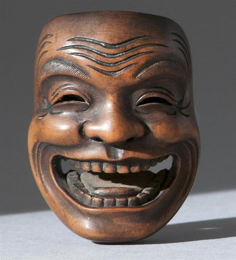 "WOOD MASK NETSUKE By Gyokusai. Depicting a laughing man. Signed. Length 2"" (5 cm)."