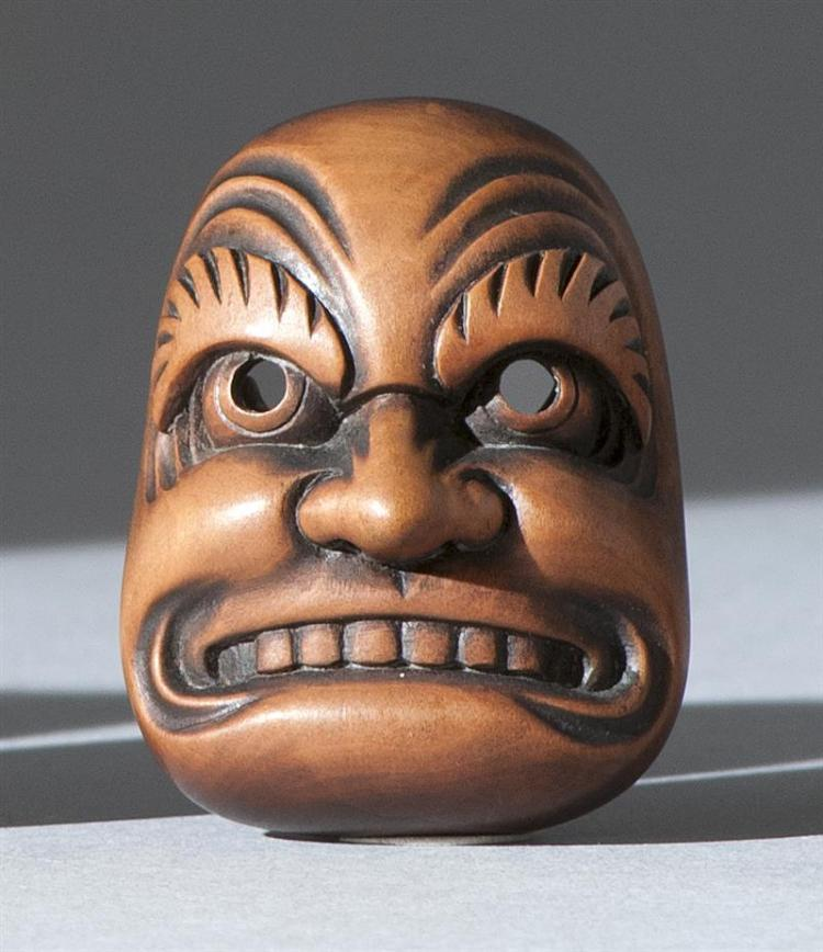 "WOOD MASK NETSUKE By Gyokusai. Depicting a grimmacing figure. Signed. Length 1.6"" (4 cm)."