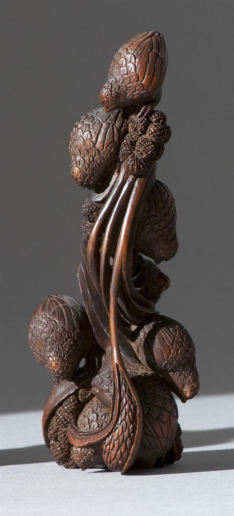 """WOOD NETSUKE In the form of a covey of quail with millet. Some with inlaid eyes. Height 4"""" (10 cm)."""