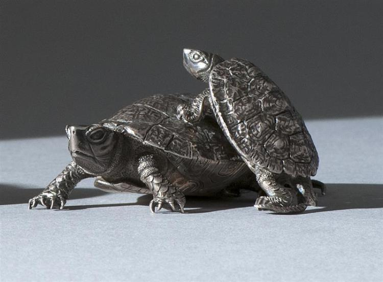 """SILVER NETSUKE In the form of two tortoises. Signed """"Nayomasa"""". Length 2.7"""" (6.8 cm)."""