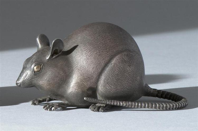 "SILVER OKIMONO In the form of a crouched rat. Signed in seal form. Length 4"" (10 cm)."