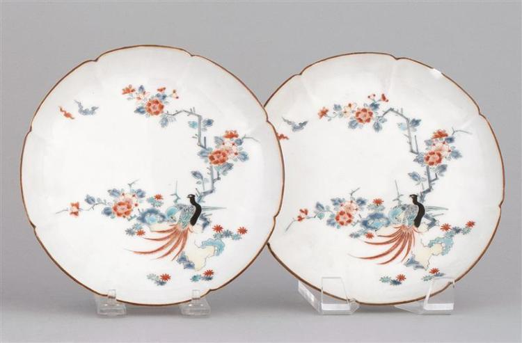 """PAIR OF KAKIEMON PORCELAIN DISHES With exotic bird and flower design. Diameters 7"""" (18 cm)."""
