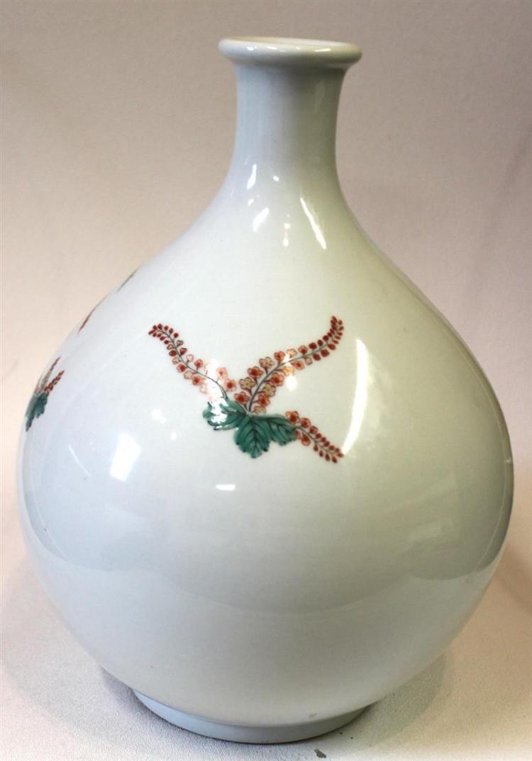 KAKIEMON PORCELAIN BOTTLE VASE In bladder form with phoenix and paulownia design. Height 11.75