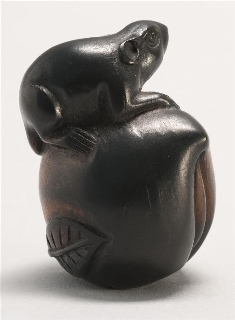 EBONIZED WOOD NETSUKE In the form of a rat resting on a large peach. Height 1.6