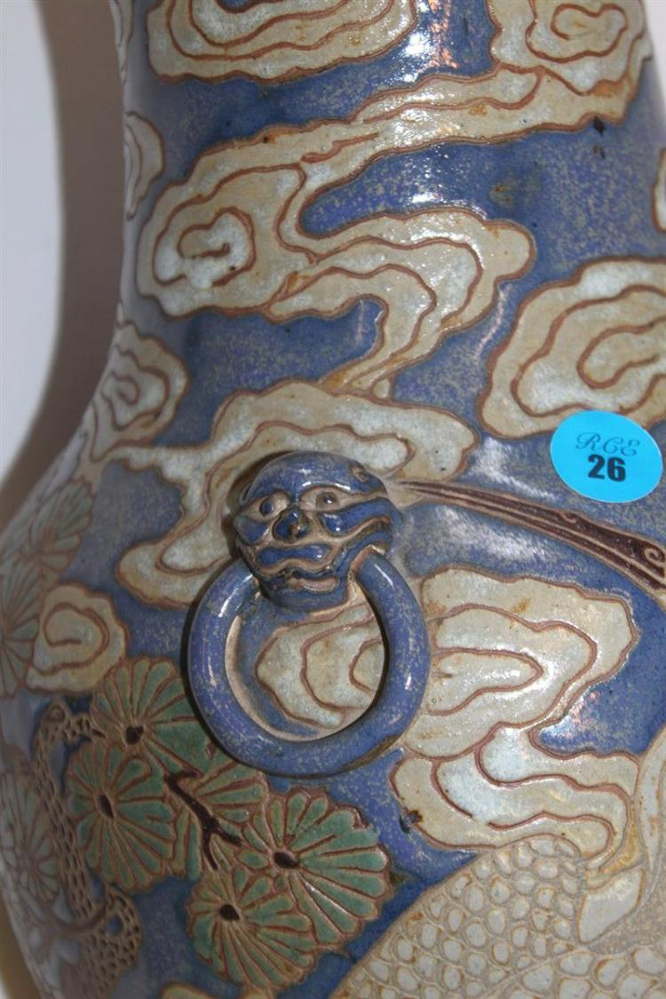 POTTERY VASE In baluster form with incised beige decoration of cranes in a chrysanthemum and cloud-filled landscape on a blue ground...