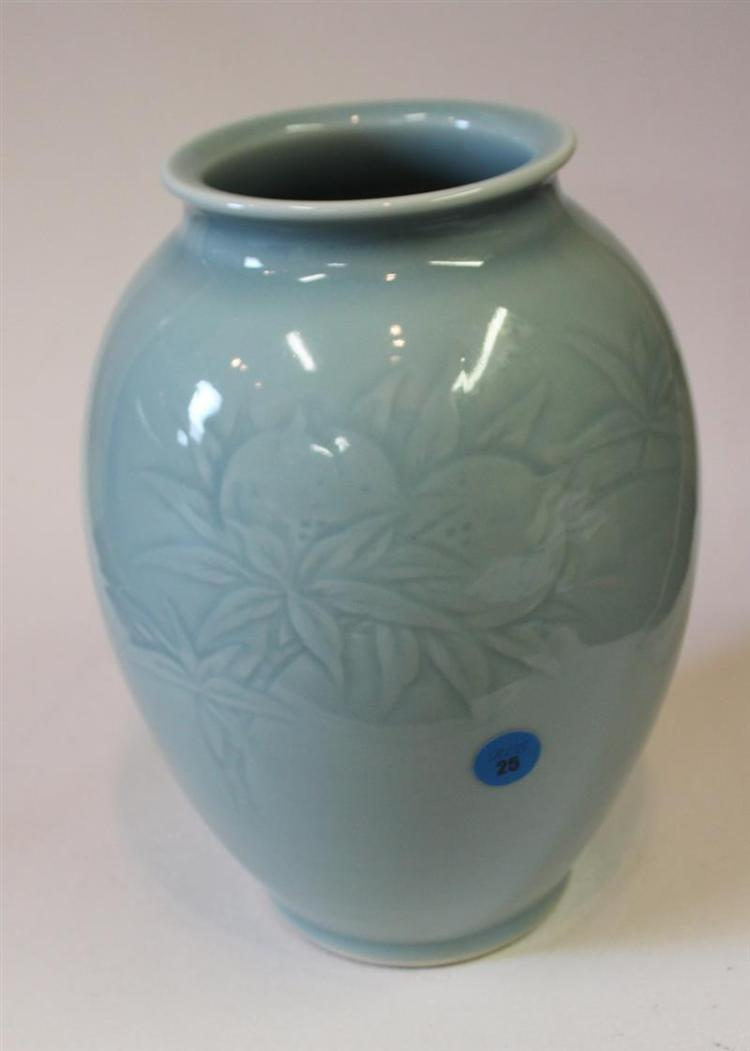 STUDIO PORCELAIN VASE In seed form with raised peach branch decoration in an allover celadon glaze. Signed on base, possibly