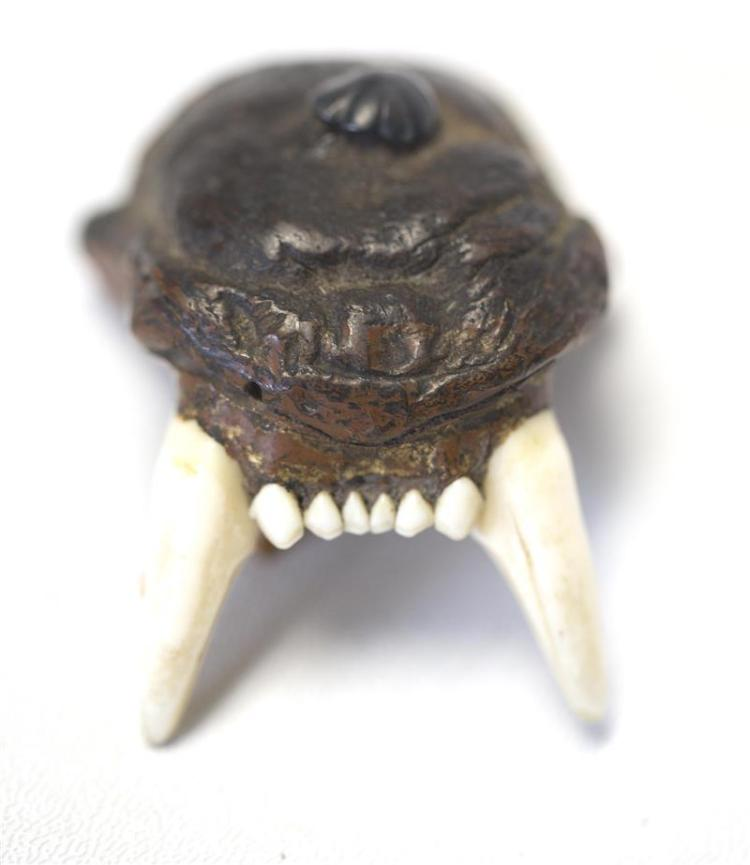 LACQUERED WOOD AND BONE NETSUKE In the form of the extinct honshu (Japanese wolf). Silver mount in himotoshi. Similar example in The...
