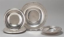 FIVE STERLING SILVER HOLLOWWARE PIECES A centerpiece bowl, three sandwich plates and a round vegetable bowl, all by various makers....