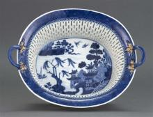NANKING PORCELAIN CHESTNUT BASKET With blue and white decoration; clobbered decoration at handles. Reticulated sides. Made for the e...