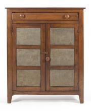 ANTIQUE AMERICAN PIE SAFE In pine, birch and other woods. One full-width drawer above two paneled cupboard doors, each with three st...