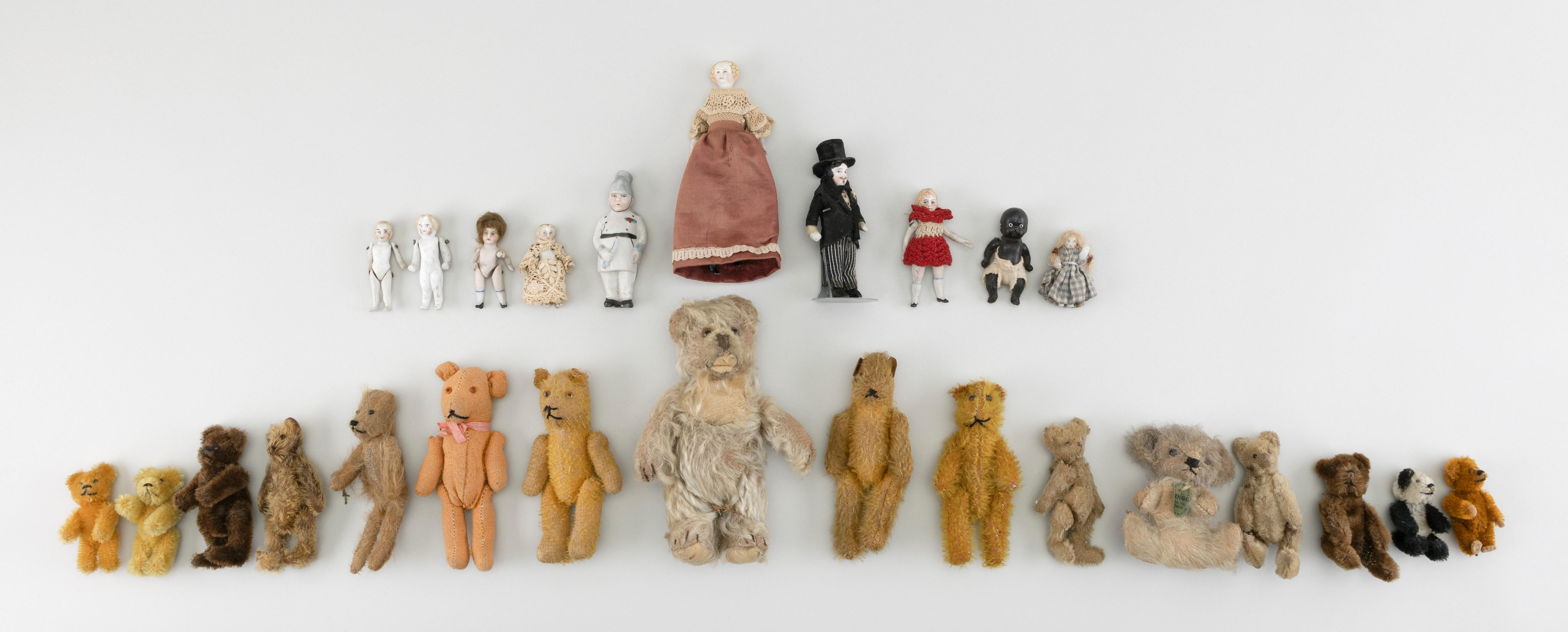 "SIXTEEN EARLY SMALL BEARS AND TEN SMALL BISQUE DOLLS 20th Century Heights from 2"" to 7""."