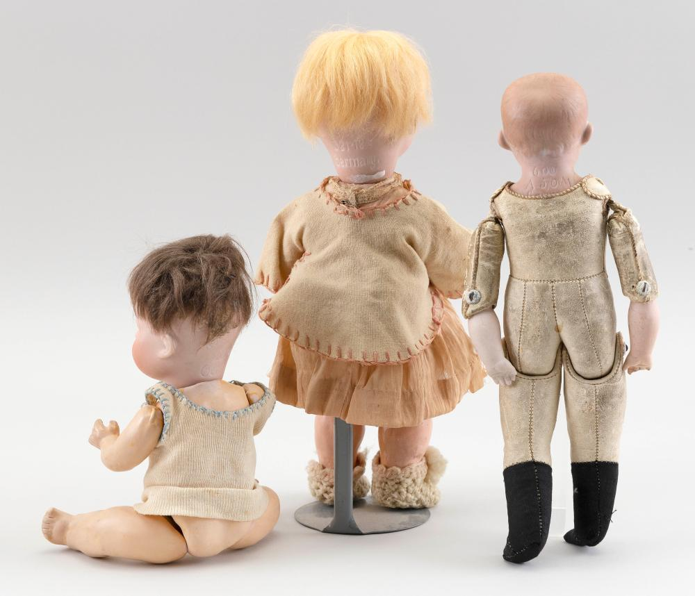 """ARMAND MARSEILLE 600 BOY DOLL AND TWO HEUBACH DOLLS Circa 1910 Heights from 8"""" to 10""""."""