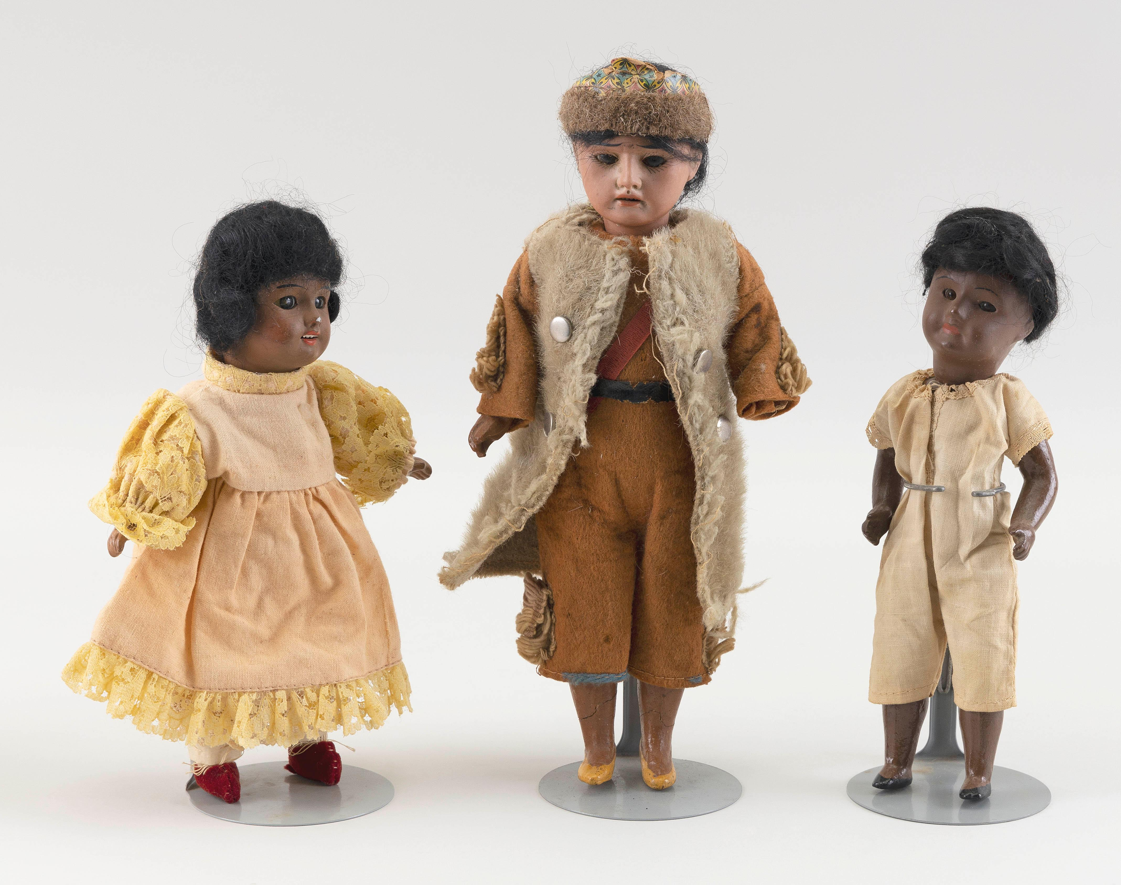 """THREE NATIVE BISQUE-HEAD DOLLS Circa 1910 Heights from 8"""" to 11""""."""